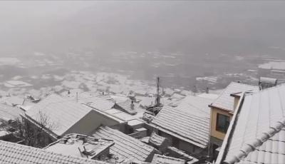 积雪浮云端,牛年第一场雪让崂山再现银色